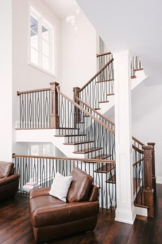 Beautiful-Stair-Rails-With-Iron-Staircase-Railing-And-Wood-Stair-Bannister-In-Interior-Designs-Black-Iron-Stair-Railing-Dark-Wood-Banister-High-Ceilings-Iro